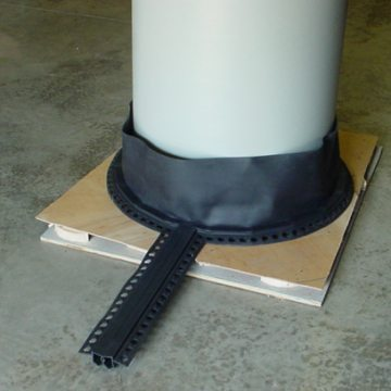 THERMAFLEX TM 2.5 parking deck joint system custom curved to ensure continuity of seal at round columns.